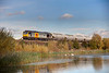 60084 passing the ponds at Horbury with a 6M22 Hunslet to Tunstead empty bogie tanks on October 22nd 2010.