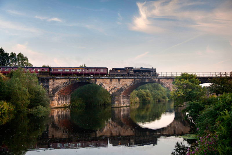 44871 crosses the River Calder east of Wakefield Kirkgate with a 1Z28 16:55 Scarborough to York Scarborough Spa Express on September 1st 2010.