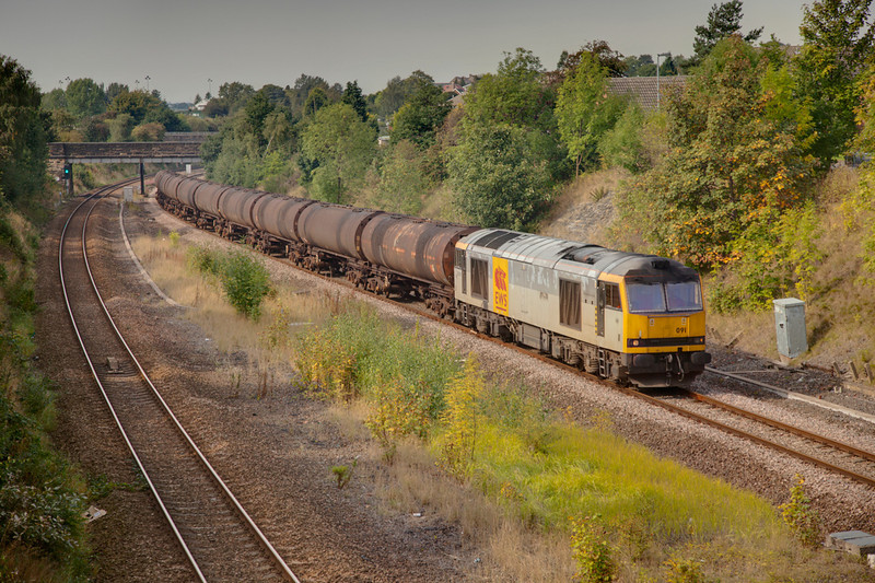 60091 in Horbury Cutting on a 6E32 Preston to Lindesy empty bitumen tanks on September 22nd 2010.