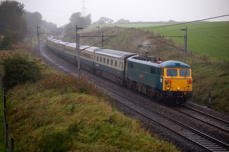 87002 at speed in the rain at Docker with a 1Z87 06:02 Watford Junction to Edinburgh Rail Blue Charters railtour on September 10th 2010.