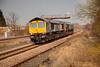 66304 passing Forge lane towing 66418 with an 0Z15 15:00 York Parcel Siding to Crewe Basford Hall on March 24th 2011.