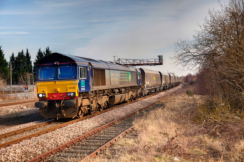 66426 pasing Forge Lane, Horbury Junction with a 4M12 11:06 Stourton to Shap empty stone train on March 1st 2011. This was a trail of a possible new flow, the wagons in use are ex fastline coal hoppers