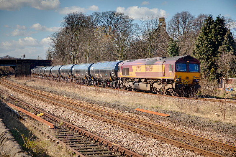 66080 passing Forge Lane Horbury Junction with a 6E32 Preston to Lindsey empty bitumen tanks on 18th March 2011