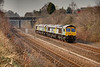 66304 leads 66301 through Horbury Cutting with an 0Z16 08:52 Crewe Basford Hall to York Parcel Sidings on March 24th 2011