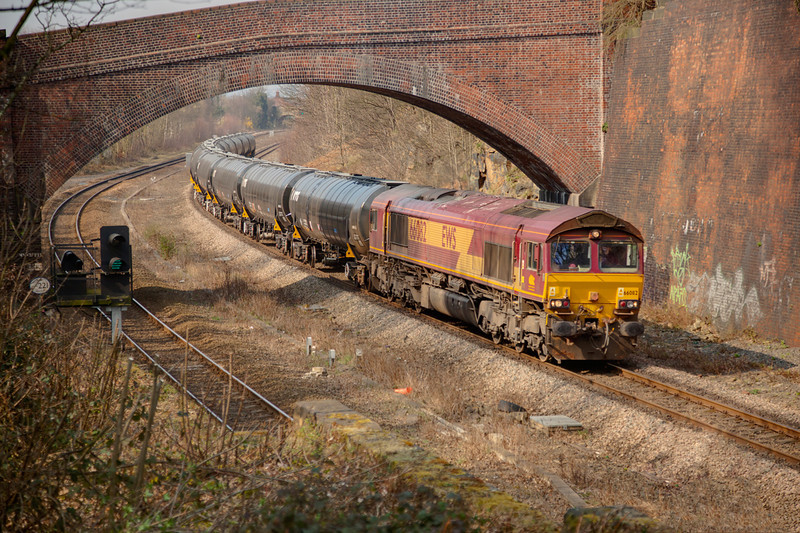 66082 yings under the bridge at Addingford Lane Horbury Cutting with a 6E32 Preston to Lindsey empty bitumen tanks on March 23rd 2011.