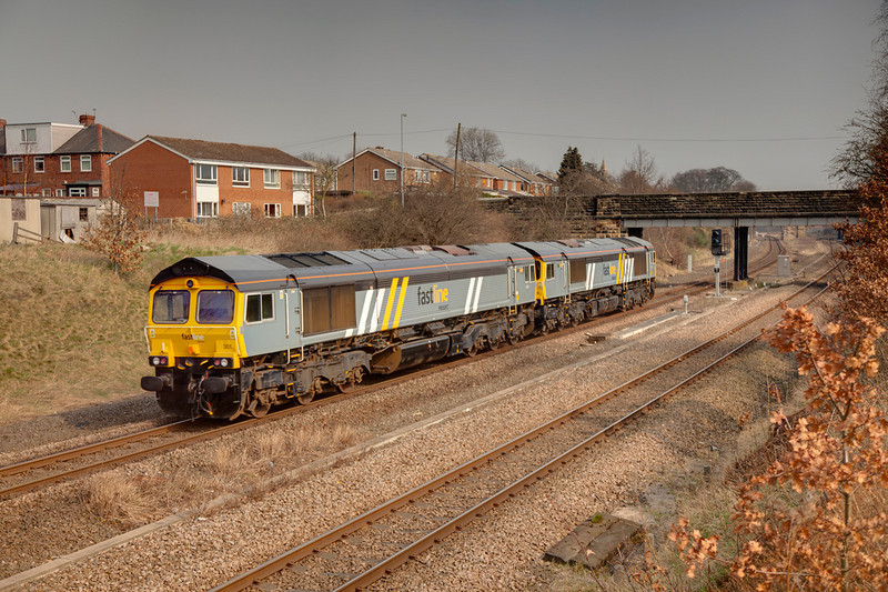 66301 trails 66304 through Horbury Cutting with an 0Z16 08:52 Crewe Basford Hall to York Parcel Sidings on March 24th 2011.