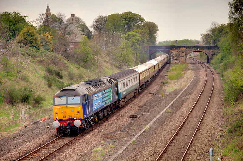 47501 at the rear of a 1Z41 07:34 Shrewsbury to Harrogate Northern Bell passing through Horbury Cutting. The lead loco was 47802