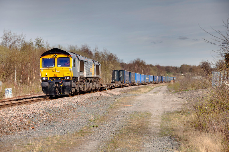 66304 passing the site of Thornhill Junction, Dewsbury with a diverted 4M16 Grangemouth to Daventry Intermodal on April 2nd 2011
