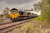 66613 passing Forge Lane Horbury Junction with a 6Z17 10:30 Hunslet to Guide Bridge on April 14th 2010