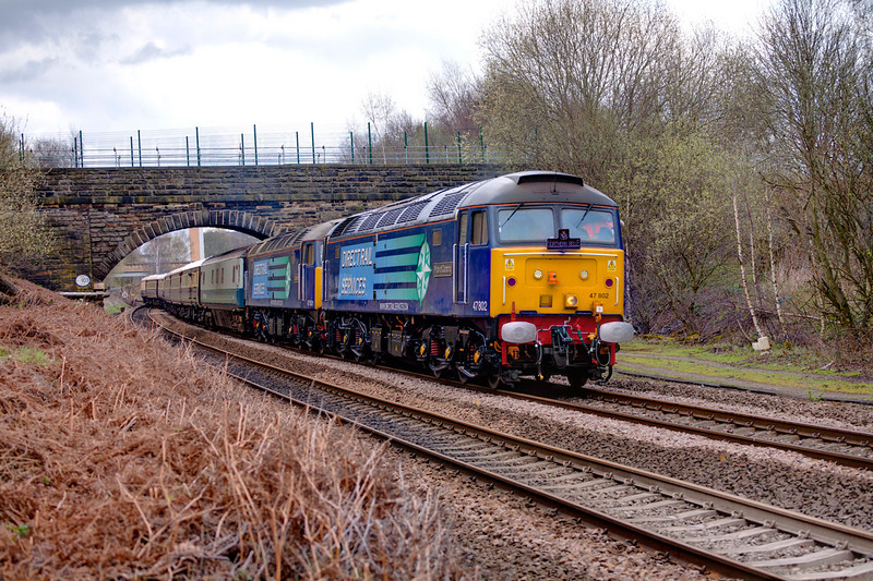 "47802+47501 cautiously negotiate Bradley Junction nr Deighton Huddersfield with a 1Z79 13:15 Liverpool Lime Street -Livepool Lime Street (via Blackburn, Copy Pit and Huddersfield) Northern Belle Mothers Day Luncheon Train on April 3rd 2011. 47790 was out of view on the rear.This weekends activities were the first trains to be operated by DRS since gaining the contract to provide the traction for the Northern Belle trains, Quite why three ""Duffs"" were supplied is unclear."