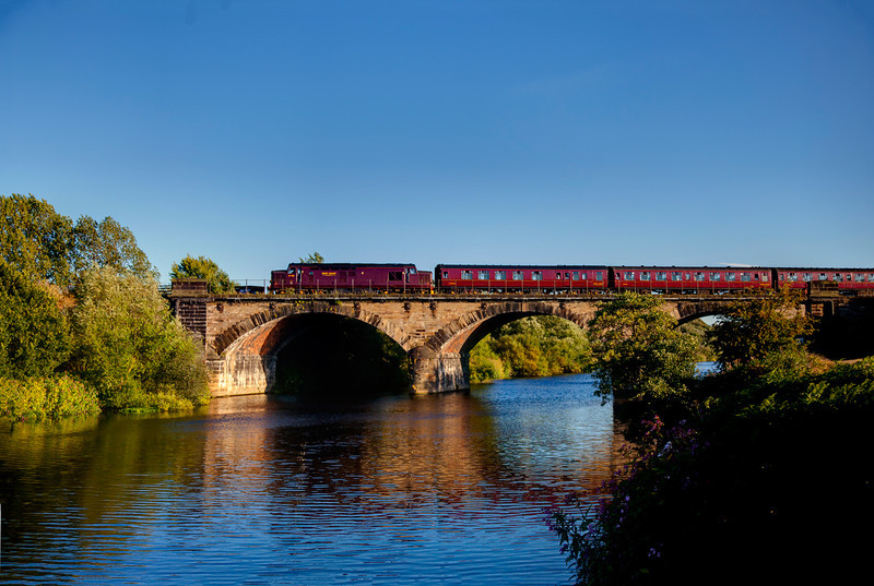 37706 brings up the rear of the 2nd circuit of the SSE with a 1Z24 16:55 Scarborough to York, crossing the river calder at Wakfefiel on 9th August 2011.