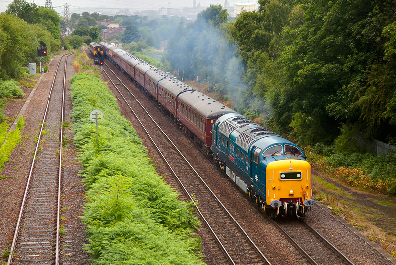 Nearly bowled by a 150! 55022 humms cautiously through the rain at Oakenshaw with a 5Z31 Carnforth to Doncaster ECS on July 8th 2011.