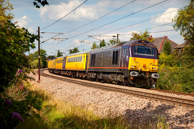 Testing by Royal Appointment.........  67005 (leads an out of sight 67006 on the rear) passed Wrentorpe, Wakefield with a 1Q18 08:26 Doncaster to Derby on July 15th 2011