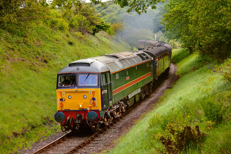 47715 powers away from Damems Loop with the 11:20 Keighley to Oxenhope in the drizzle on May 20th 2011