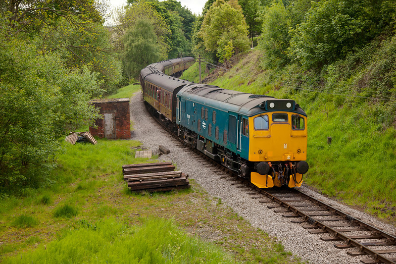 25059 sweeps around the curve about to enter Mytholmes Tunnel with the 10:30 Oxenhope to Keighley on May 20th 2011