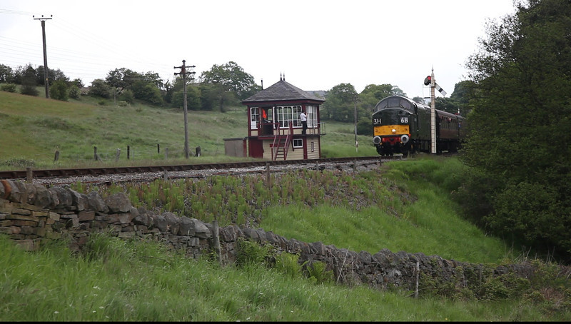 "The National ""Tractor"" D6700 powers away from Damems Loop with the 12:05 Keighley to Oxenhope after recieving the token on May 20th 2011"