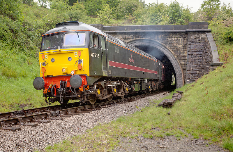 47715 bursts out of Mytholmes tunnell into the rain with the 12:15 Keighley to Oxenhope on May 20th 2011.