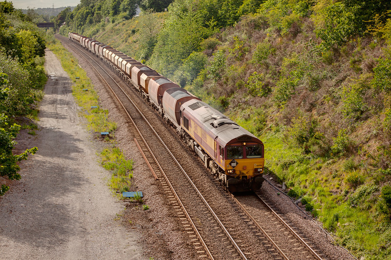 66096 is seen on the approach to Dewsbury East Junction with the first run of a new stone flow, a 6Z33 Blackburn to Radlett on May 18th 2011, complete with HM Depot Diamond Headboard.