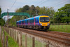 185148 passing the footbridge at Brock with an Edinburgh to Manchester Airport on 6th May 2011