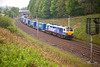 "92017 sweeps around the curve at Beck Foot with the 4S43 06:15 Rugby to Mossend ""Lesco"" express on May 6th 2011."