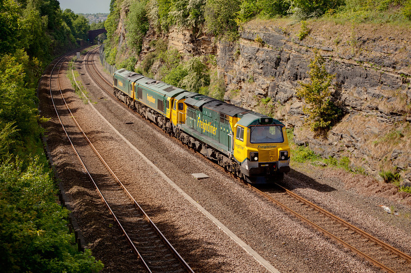 70011 is seen in Horbury Cutting passing Slazengers Bridge with an 0Z70 Crewe to Midland Road loco trip conveying 66617+66618 on May 9th 2011.