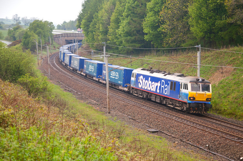 """92017 """"Bart the Engine"""" sweeps around the curve at Beck Foot with the 4S43 06:15 Rugby to Mossend """"Lesco"""" express on May 6th 2011."""