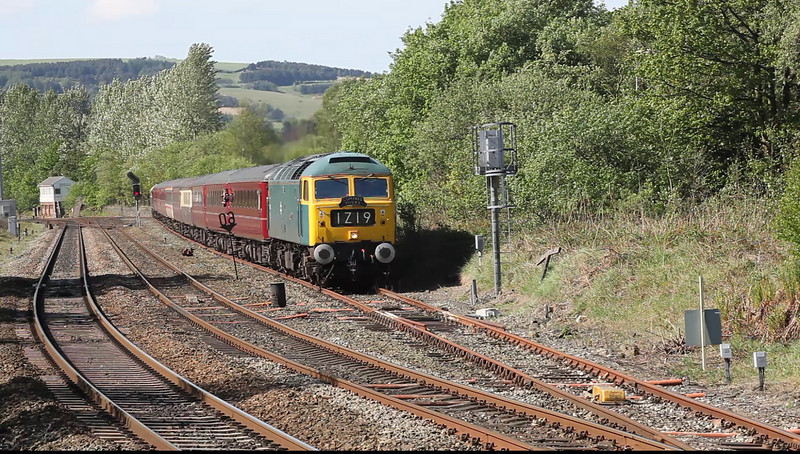Bowled by the signaller!!  Why let him out of the loop if the signal guarding the tunnel (15m out the loop) is still at danger?  47270 crawls out of the loop and stops at Diggle with the 1Z19 07:35 Southport to Carlisle charter for Compass Tours on May 2nd. 2011.