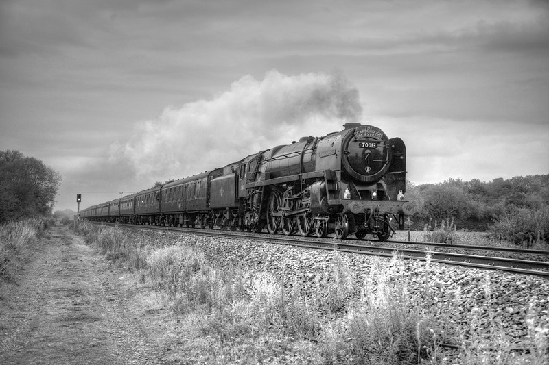 Looking far better for the B&W conversion, 70013 rockets past Little Fenton in crappy light with a 1Z24 16:55 Scarborough to York SSE on August 31st 2011