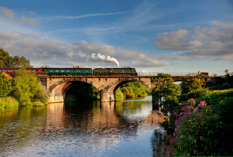 """34067 Tangmere blows of her saftey valve as she crosses the River Calder slowing,  20 mins early for the Wakefield Kirkgate stop of the 1Z69 16:55 Scraborough to Crewe return """"Scarborough Flyer"""" on July 29th 2011"""