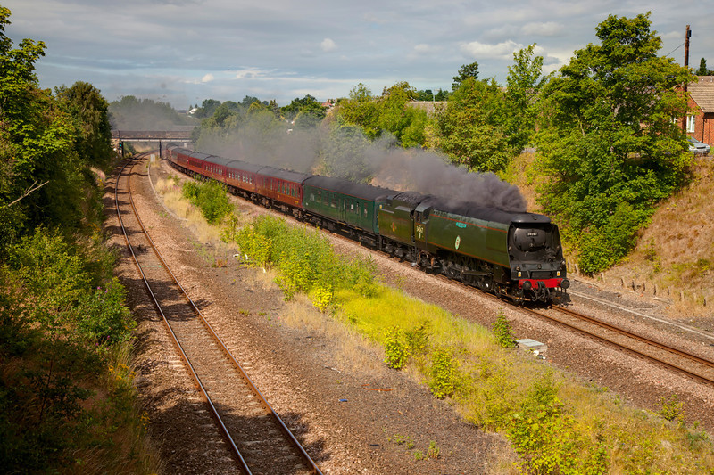 "Not working anywhere as hard as the smoke effects would have you believe, 34067 Tangmere slows as she approaches Horbury Junction with a 1Z68 07:11 Crewe to Scarborough, Th e First ""Scarborough Flyer"" of the 2011 season on July 22 2011."