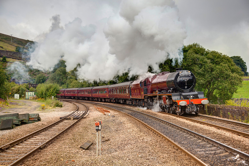 """Proof you should never look a gift horse in the mouth??  <br /> <br /> I awoke to clear blue skies but decided to look at a shot I have been thinking of for a while now, only to find it cloudy when i got there Doh!!  Stanier's graceful """"Princess Elizabeth"""" 6201 is seen exiting the Standedge Tunnle at Tunnel End, Marsden bang on time with a 1Z68 07:11 Crewe to Scarborough """"Scarborough Flyer"""" on August 19th 2011.  In the words of a fellow local tog """"You should have stayed at home mate!"""" - very true Derek, not only did the sun not want to play but trees have now also obscured the Aquaduct from view too....:-(<br /> <br /> PS before I get cries of """"Tresspass"""" messages this is a 100% legal shot from behind the fence!"""
