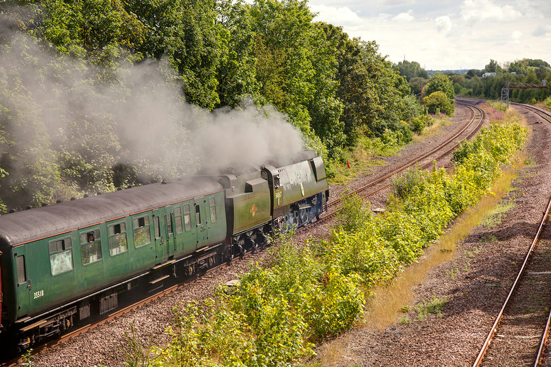"""34067 Tangmere slows as she approaches Horbury Junction with a 1Z68 07:11 Crewe to Scarborough, Th e First """"Scarborough Flyer"""" of the 2011 season on July 22 2011. The return trip was delayed just short of an hour while spare parts were """"borrrowed"""" from NRM """"spam can"""" Winston Churchill."""