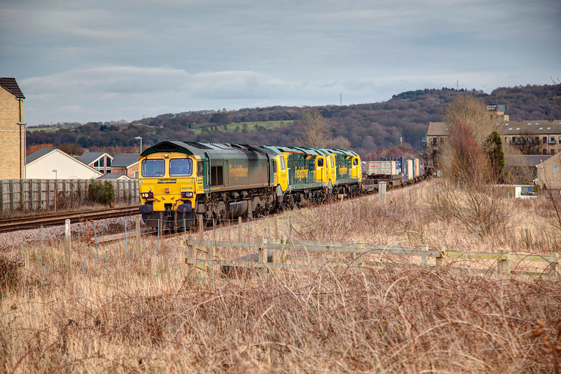 66516+70019+70020 roll past Mirfield at a snails pace around 20mins late with a 4M22 Leeds FLT to Crewe Basford Hall container train on 25th February, 2012