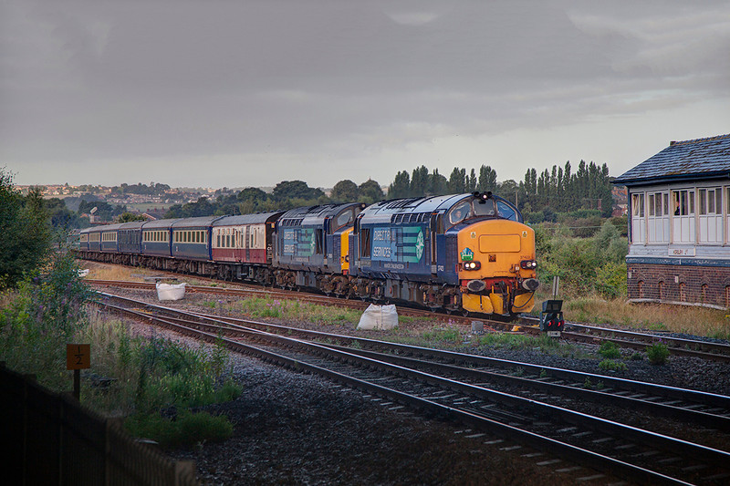 37423+37605 pass Horbury Junction with an 05:16 Crewe to Norwich tour for Retro railtours on 31st August 2013