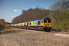 "Rainbow Sand<br /> <br /> 66720 in ""child's play graffiti"" livery, rolls past Royston Junction with the 6E84 08:20 Middleton Towers to Monk Bretton Sand train on 15th April 2014."