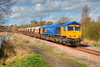 Finally got one in Sun at Pools Lane! :-)<br /> <br /> 66722 'Sir Edward Watkin' rolls past Pools Lane Royston with the 6E84 08:20 Middleton Towers to Monk Bretton on 8th April 2014.  This is one of only two locomotives now carrying this livery.