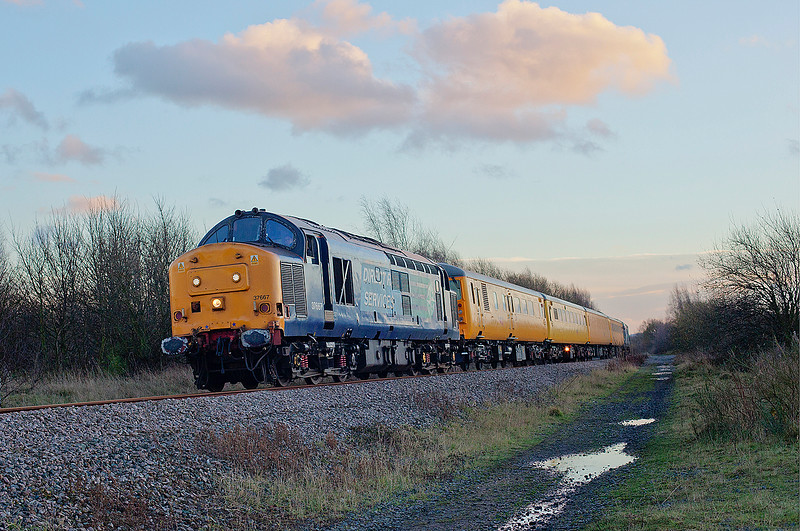 "37667+37610 are seen passing Royston just south of Pools Lane after departing Monk Bretton Loop with a 1Q05 11:44 Tees Yard to Derby RTC on 12th December 2014.<br /> <br /> I was very nearly bowled by the wife on this shot as despite giving her adequate warnings were still in MeadowHell car park at 14:20!  A very fast car home to drop her off and pick up my camera for an equally fast dash down to Royston, only to get bowled after all by the weather.  The sun just dipped behind a bank of cloud seconds before I heard the growl!  A mile up the line at Cold Hiendly Neil Harvey  <a href=""https://www.flickr.com/photos/neil_harvey_railway_photos/"">https://www.flickr.com/photos/neil_harvey_railway_photos/</a>)got a cracker of a shot! <br /> <br /> I suppose you win some and you lose some......"