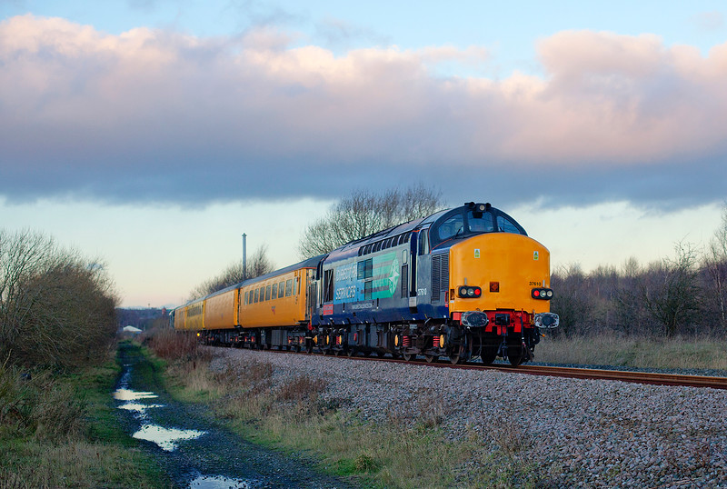 "37667 brings up the rear of a 1Q05 10:44 Tees Yard to Derby RTC just south of Pools Lane at Royston ( with the recently announced doomed Mockton Coking Plant in the backdrop) on 12th December 2014.<br /> <br /> I was very nearly bowled by the wife on this shot as despite giving her adequate warnings were still in MeadowHell car park at 14:20!  A very fast car home to drop her off and pick up my camera for an equally fast dash down to Royston, only to get bowled after all by the weather.  The sun just dipped behind a bank of cloud seconds before I heard the growl!  A mile up the line at Cold Hiendly Neil Harvey  <a href=""https://www.flickr.com/photos/neil_harvey_railway_photos/"">https://www.flickr.com/photos/neil_harvey_railway_photos/</a>) got a cracker of a shot! <br /> <br /> I suppose you win some and you lose some......"