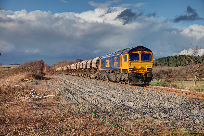 If at first you don't succeed, try again :-) this time the sun played ball and a clean loco helped make the shot. <br /> <br /> 66702 'Blue Lightening' is seen passing Cold Hiendley with the 6E84 08:20 Middleton Towers to Monk Bretton on 20th February 2014