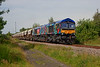"""Finally got """"the black un"""" in sun!<br /> <br /> 66718 rolls past Pools Lane Royston with the 6E84 08:20 Middleton Towers to Monk Bretton sand train on 10th July 2014"""