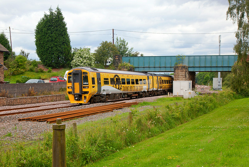 """158849 on I beleive the first day of running in """"Le Tour"""" livery passing the site of the former Crigglestone Station with the 1Y33 13:05 Leeds to Nottingham on 29th June 2014"""