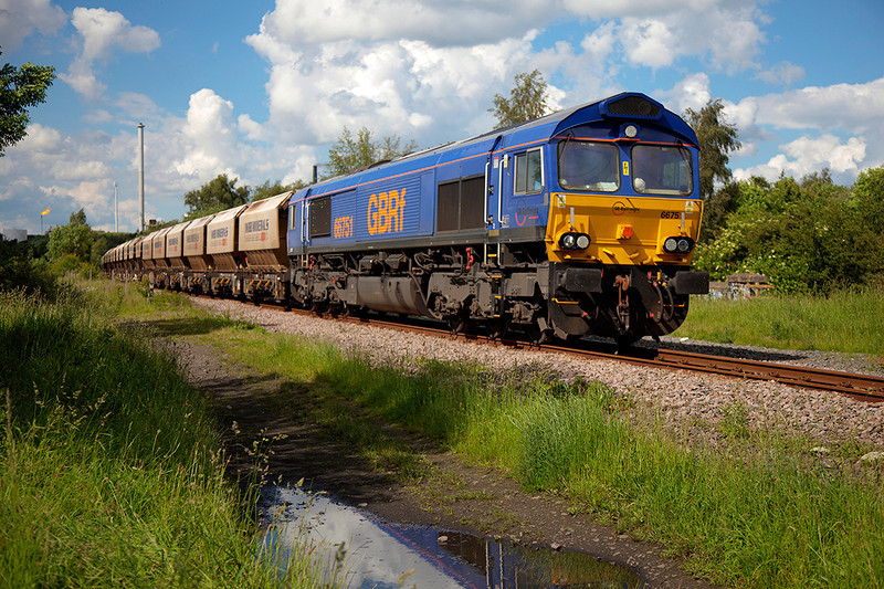 66751 rolls past Pools Lane Royston with the 6E84 08:20 Middleton Towers to Monk Bretton Sand Train on 10th June 2014
