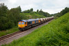 66710 rolls through Royston Cutting with the 6E84 09:44 Middleton Towers to Monk Bretton on 17th June 2014