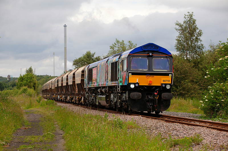 """The sun never seems to play out when the GBRF  """"power man"""" sends something not Blue & Yellow down the Monk Bretton Branch!  <br /> <br /> 66718 is seen here passing Pools Lane, Royston with the 6E84 08:20 Middleton Towers to Monk Bretton on 24th June 2014"""