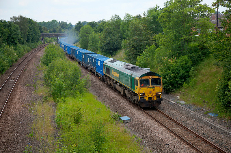 """With some of the Freightliner """"Freds"""" now over 15 years old they are now looking a little unloved.  One such Example 66528 is seen here, the train braking hard for  a signal check at Horbury Junction with a 6S34 (SUN) 10:45 Northenden to Oxwellmains on 22nd June 2014"""
