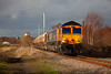 66715 ' Valour' in a lucky patch of sunlight passing Pools Lane Royston, with Royston Coking Plant visible in the distance, working the 6E84 08:20 Middleton Towers to Monk Bretton on 18th March 2014