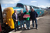 Four members of the HMPS (from Left to right Pauline McKenna, Nigel Cockburn, Myself and Steve Jackson) pose with HMPS headboard prior to departure of the return leg of the 'The Deltic Aberdonian' railtour on 12th April 2014