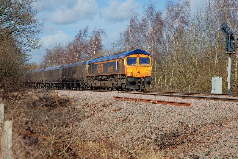 66756 is seen signal checked at Shaftholme Jcn while in charge  of a 6B93 08:38 Tyne Dock to West Burton Power Station on 23rd February 2015
