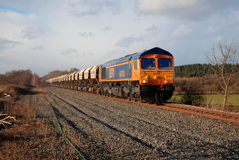 66760 passing Cold Hiendley in stunning light working a 6E84 08:20 Middleton Towers to Monk Bretton Sand train a few mins early on 24th February 2015