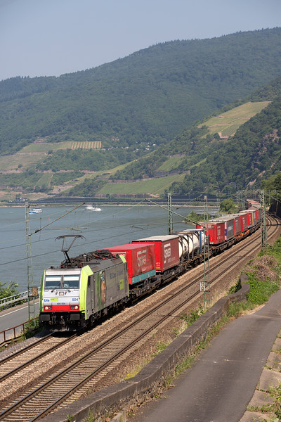 A colourful 486-504 heads a mixed container train southwards at Assmanshausen on 12th June 2015